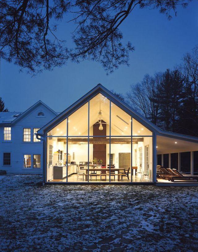 snowy farmhouse at night